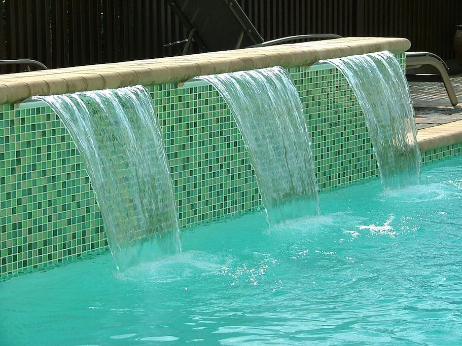 Beatuiful water feature in the private pool