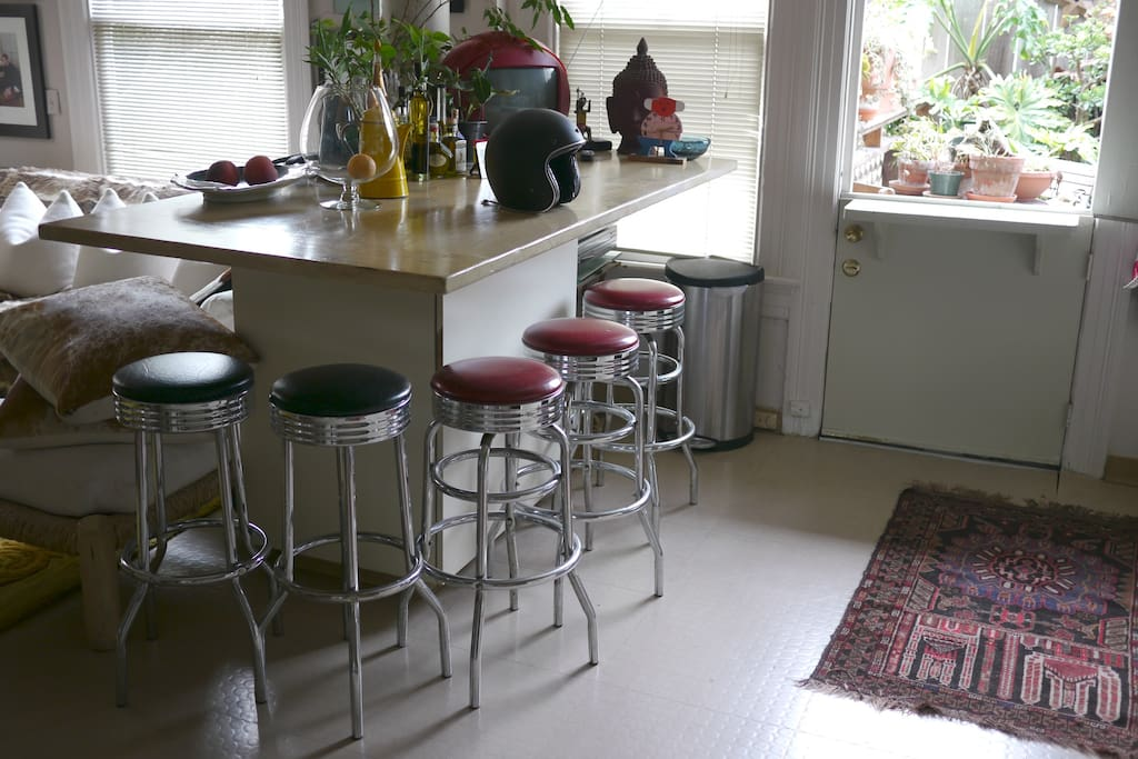 Casual dining in our kitchen area — with a nice (small) patio/garden in the back...