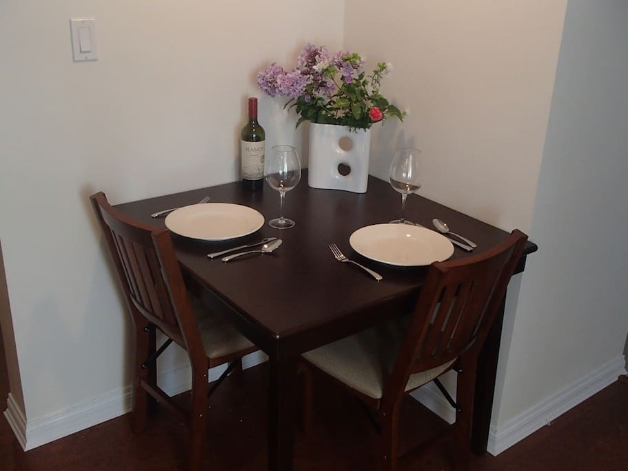 Kitchen table - 2 seats shown, 2 additional seats available.