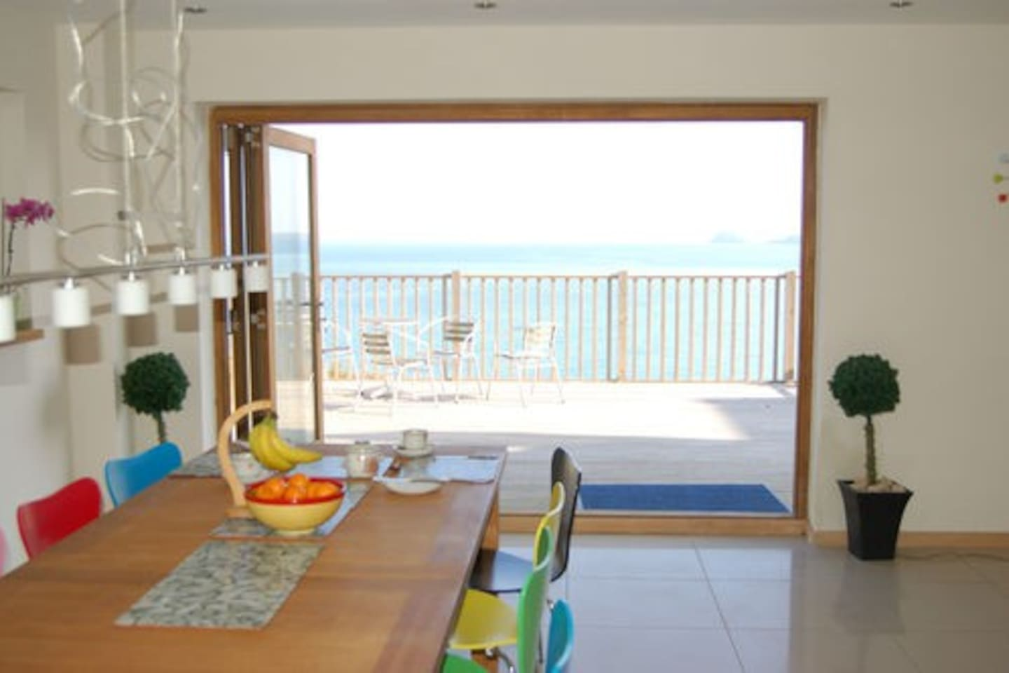 Dining room and deck overlooking beach
