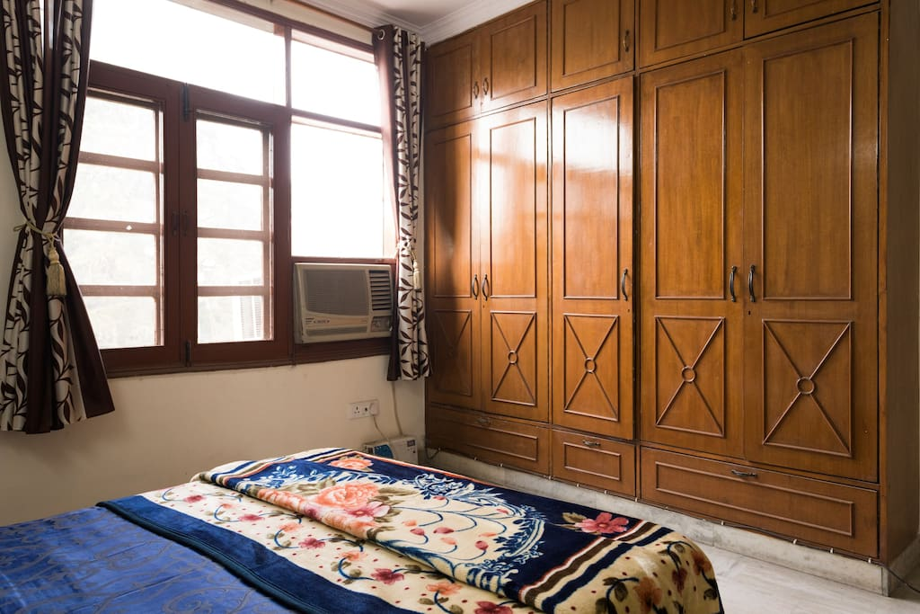 The bedroom has spacious cupboards for storing luggage and clothes.