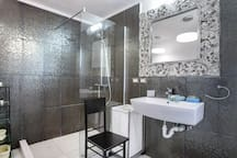 Private spacious bathroom of the master bedroom, fresh towels, linen, essentials are included