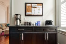 Kitchen amenities including a variety of locally roasted coffee grounds