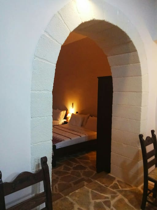 Stone arch and bedroom