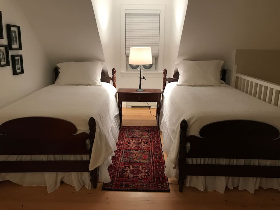 The twin loft bedroom has lovely vintage beds with new mattresses and high quality linens.