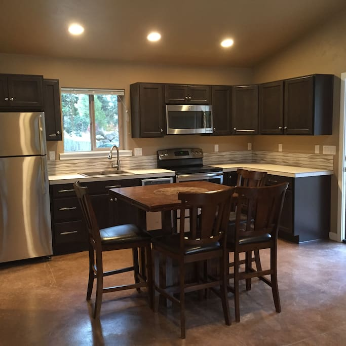 Full kitchen and table for 4.