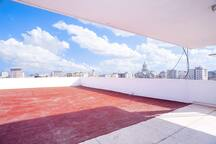 Large terrace with 360 degree view of the city and the sea