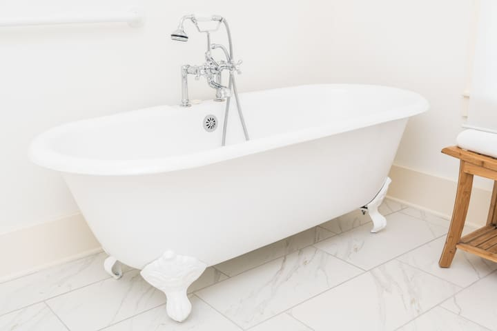 Clawfoot tub with chrome Victorian fixtures in the Twin Oaks King Suite.