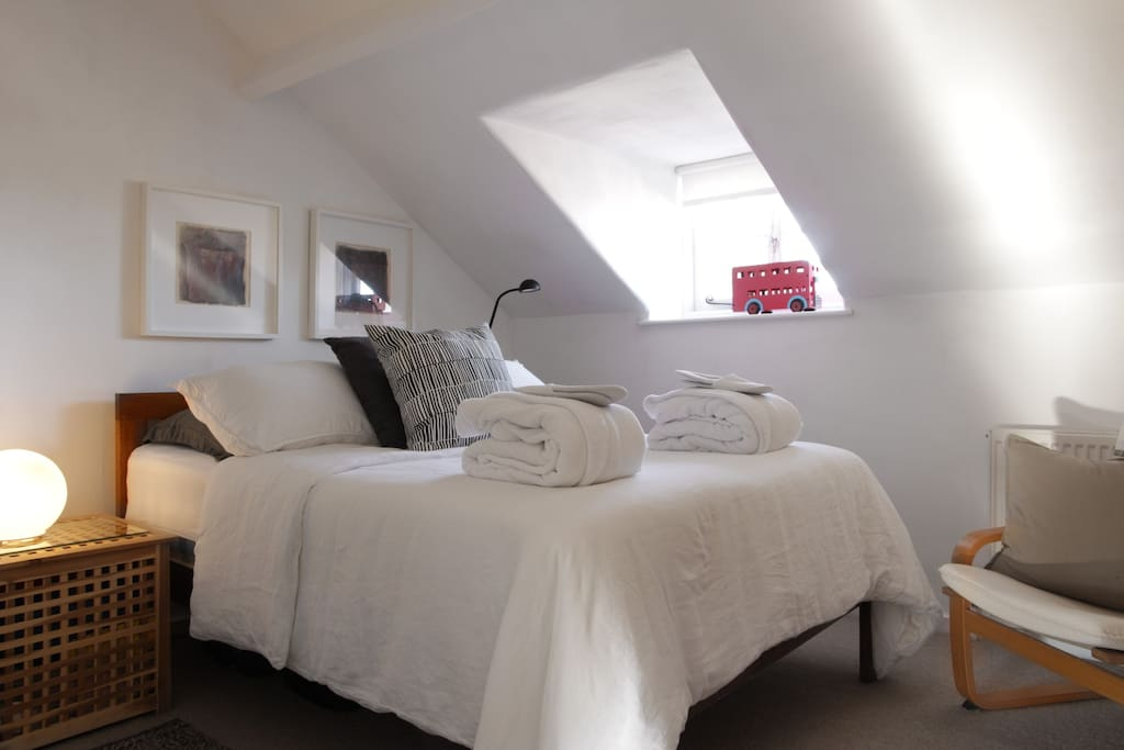 comfy bedroom and the top of the house with  a peep of the Church Steeple