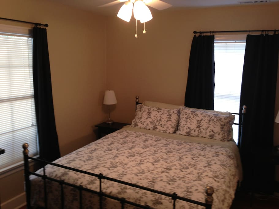 Cozy bedroom with queen sized bed and full dresser