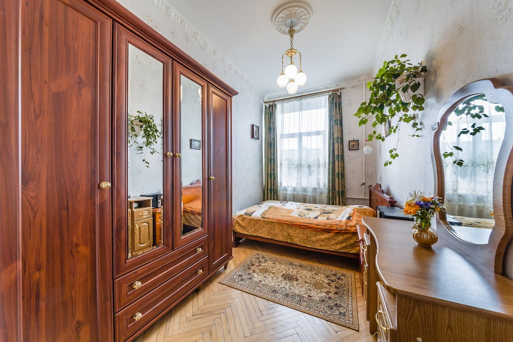 First bedroom contains double bed, toilet table, wardrobe. It is very cozy and charming.