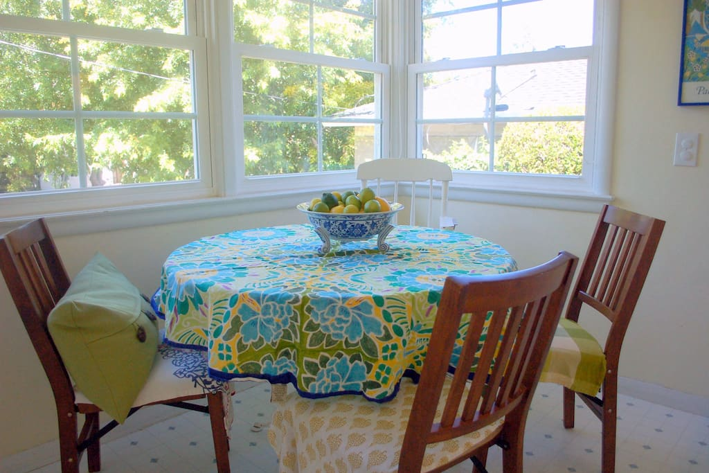 Charming, vintage eat-in kitchen seats 4. East facing window gets tons of morning sunshine