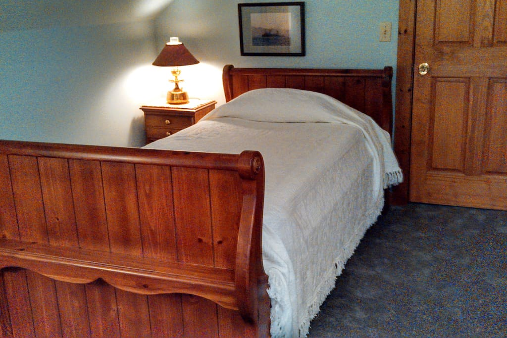 The sleigh bed for one in Guest Room 2.