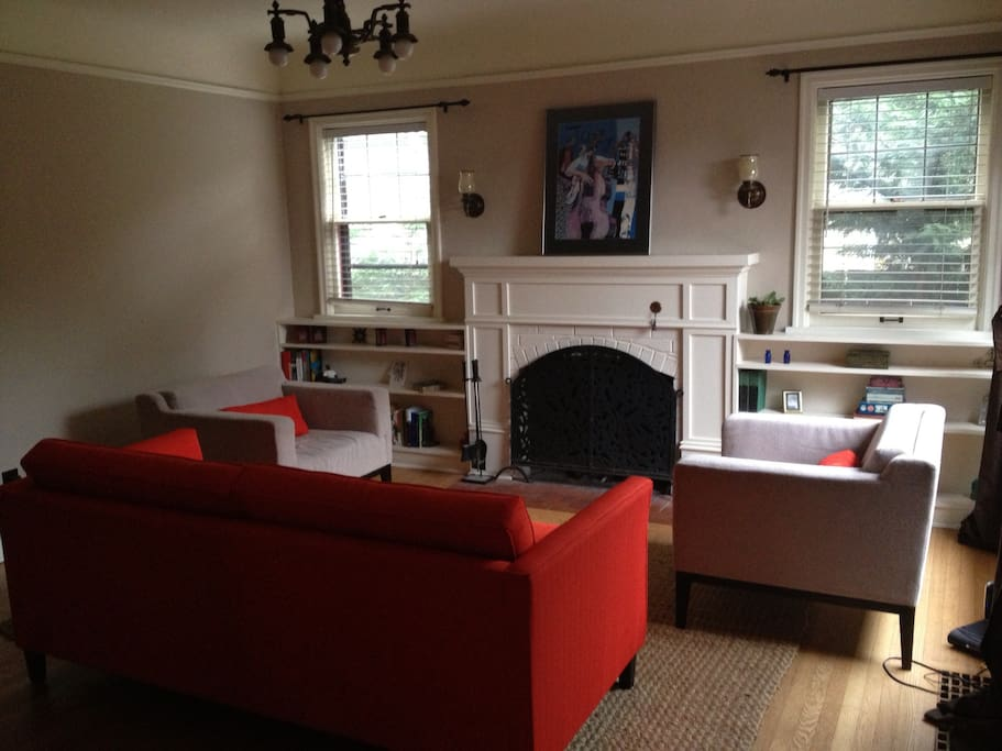 Working fireplace and comfortable living room to kick up your feet after a long day of exploring Portland.
