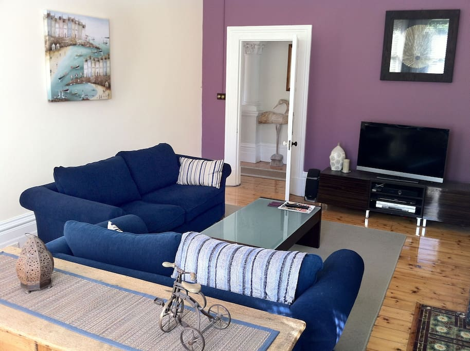 Lovely light filled lounge with comfy sofas and large TV