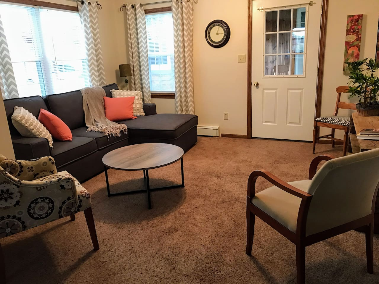 Living room with  big screen TV and easy and comfortable pullout couch.