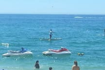 jet ski and stand up paddle rentals steps away at Medano Beach