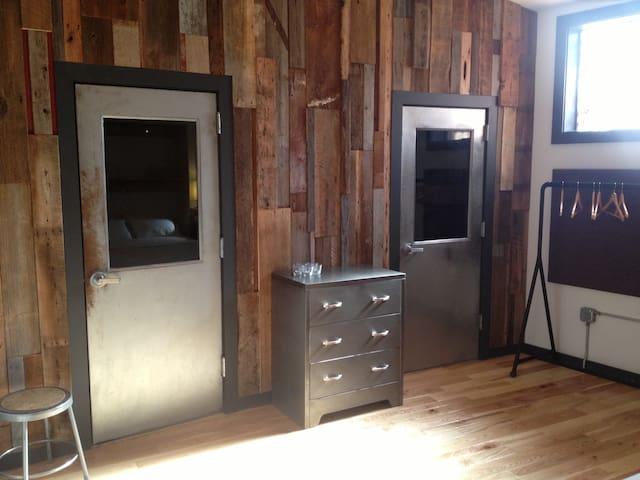 New reclaimed wood wall in bedroom