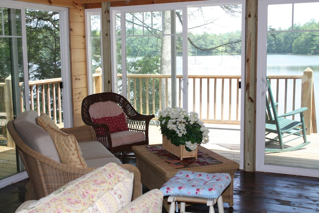 Comfortable seating area in the sun-room with views of the pond and woods.