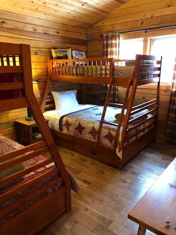 Second bedroom with two twin-over-full bunk beds.