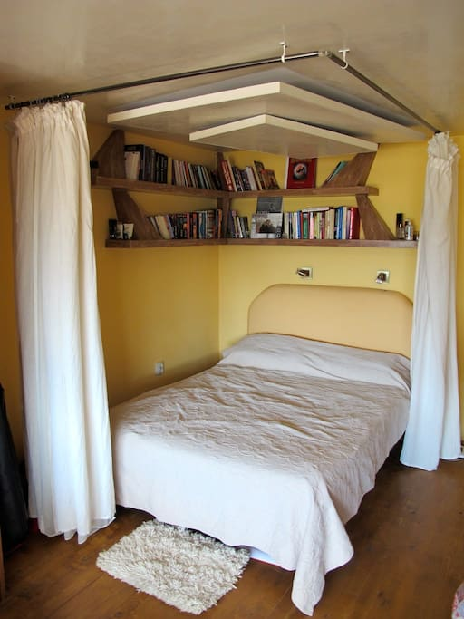 Our comfortable bed and mini library