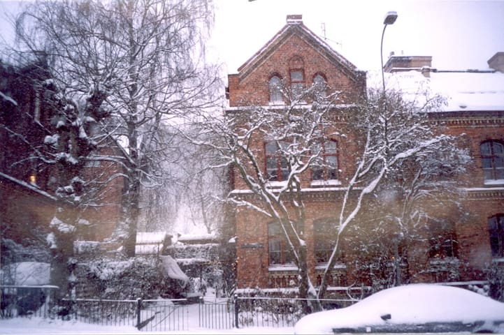 Front of building, winter.