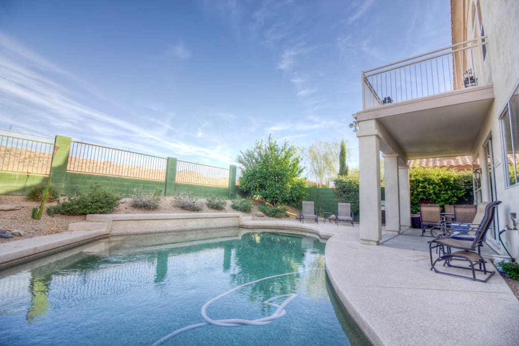 Private pool with covered patio, plenty of seating and a grill