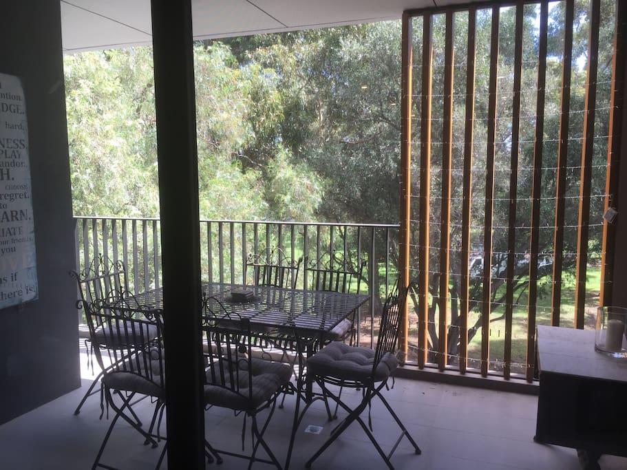 Balcony overlooking park