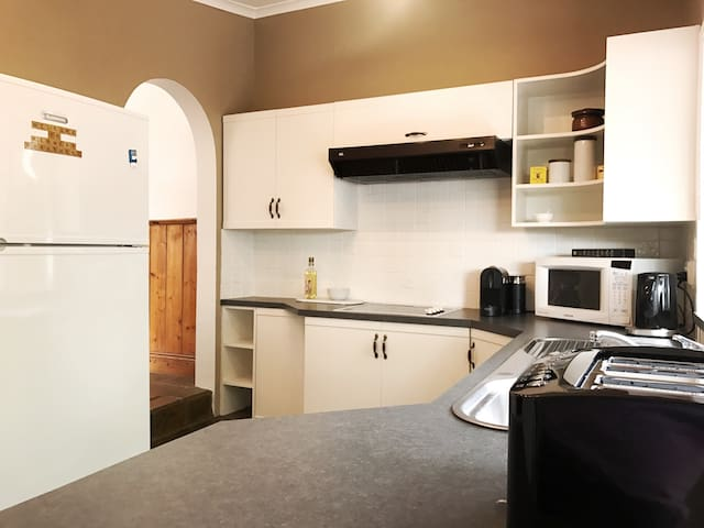 Kitchen includes oven, ceramic cooktops and modern appliances including Nespresso Machine with pods supplied.