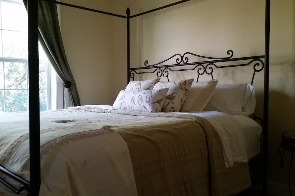 King-size bed with firm mattress and thick pillow top.