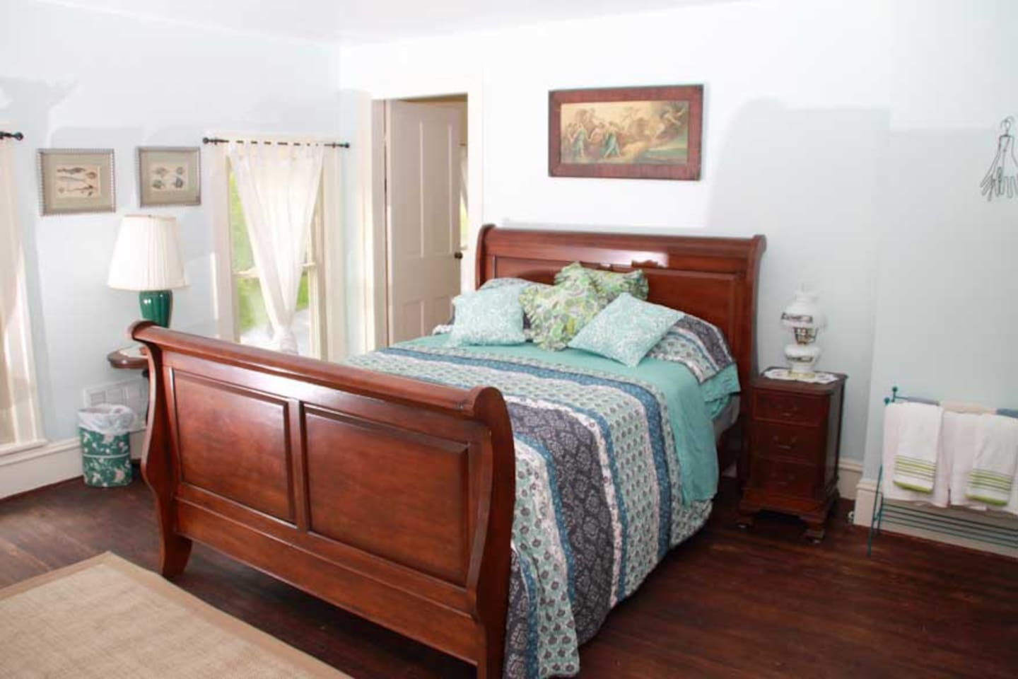 Old world charm! RIVER VIEW! Our sleigh bed offers comfort in a large room with serene colors!