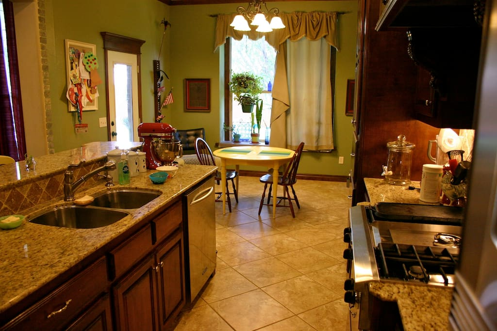 Gourmet kitchen with granite counter tops and breakfast eating area