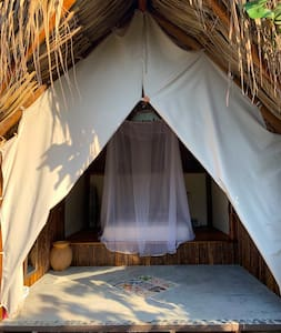 Each of our Eco Beach Hut comes with a double orthopedic mattress, privacy curtain, mosquito net, fan, safe and hangers for clothes.