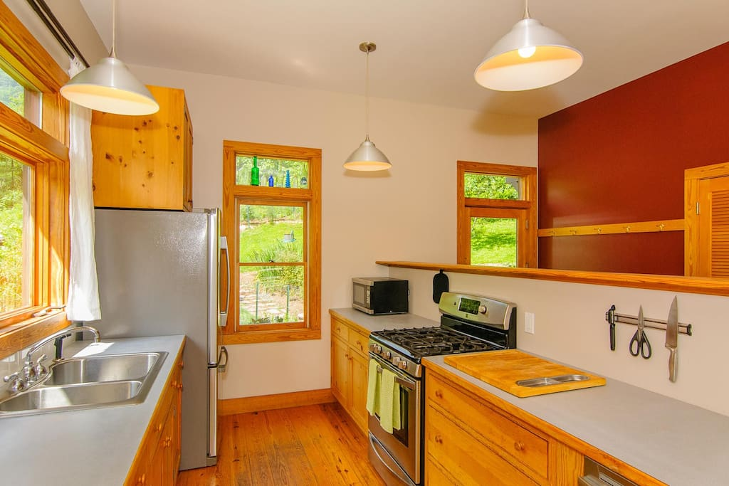 Gas stove, dishwasher, nice pots, pans and small appliances.
