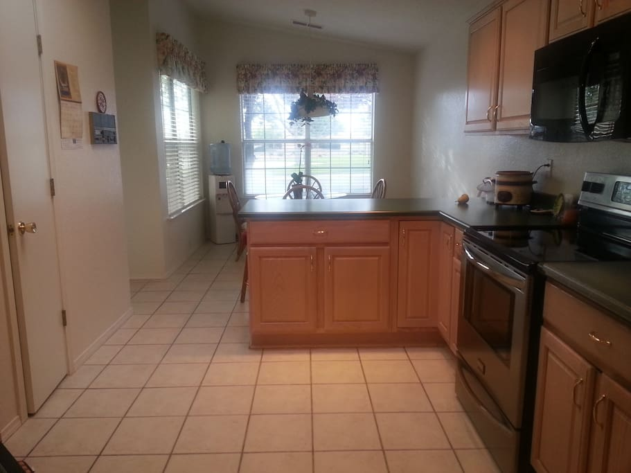 Large spacious Kitchen with new appliances, a breakfast nook overlooking pool, with skylights.