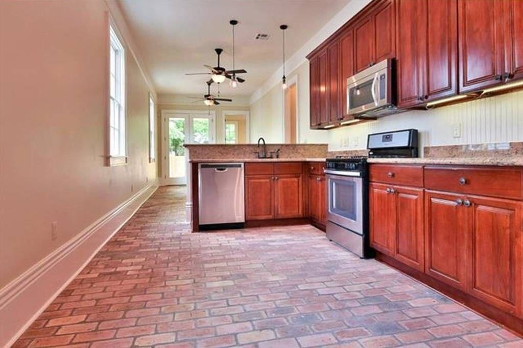 Sunlit kitchen with  brick floor and all new appliances.
