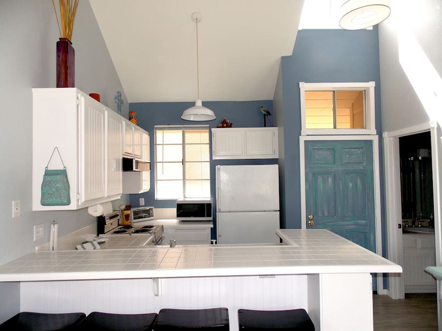 Full kitchen with refrigerator, microwave, oven, dishwasher.