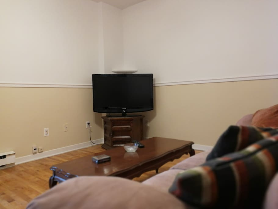 Large living room with 40 inch flat screen TV equipped with cable and chromecast