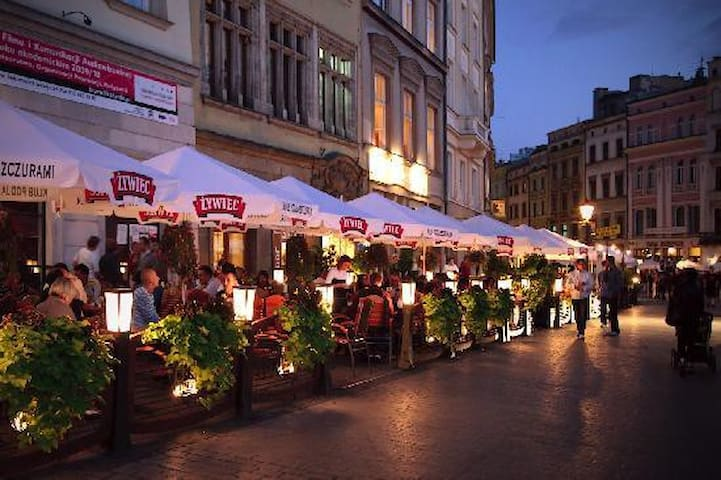 Outdoor cafes and restaurants in the Main Market square bustling with activity - (c) TripAdvisor
