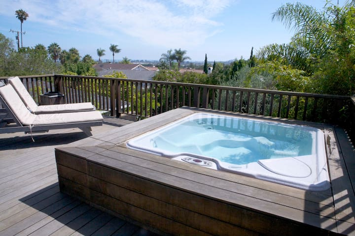 Enjoy views of the ocean and city from the hot tub