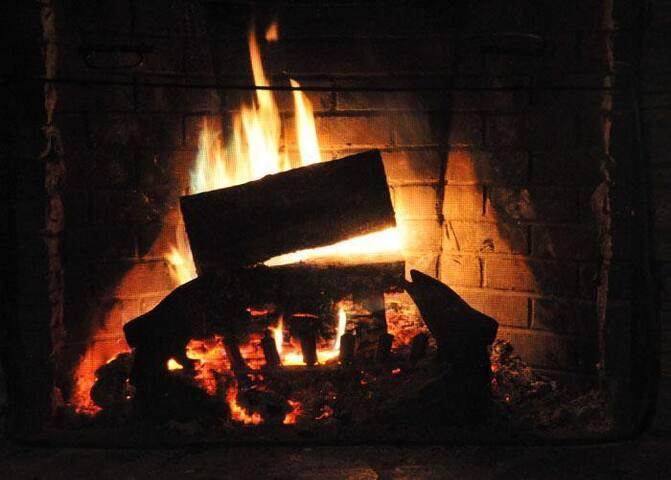 Fieldstone fireplace fire