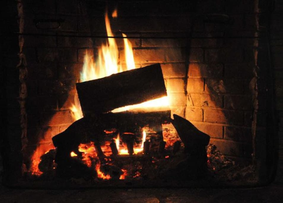 Fieldstone fireplace fire