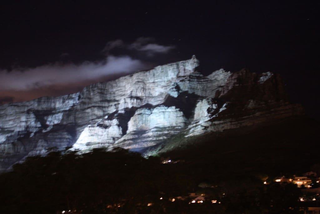 Magnificant view from the apartment - Table Mountain by night when lights are switched on!