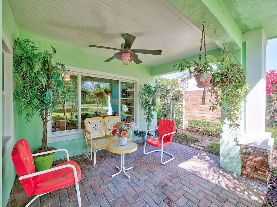 Sip morning coffee on the charming front porch lined with potted plants.
