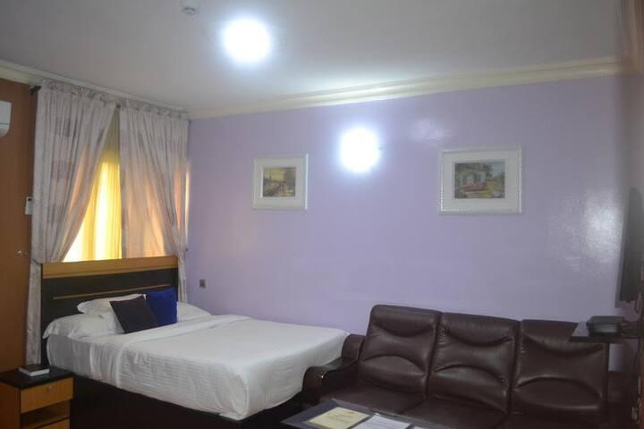 Sweet Savor Hotel - Deluxe Room