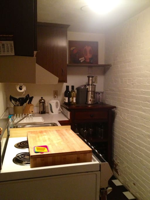 Fully equipped kitchen with stove, oven, microwave & full size refrigerator