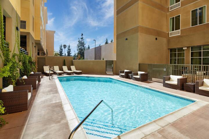 Outdoor Pool + Free Breakfast | Suite Only 20-Minute Walk to Downtown Disney and Disneyland Monorail Entrance
