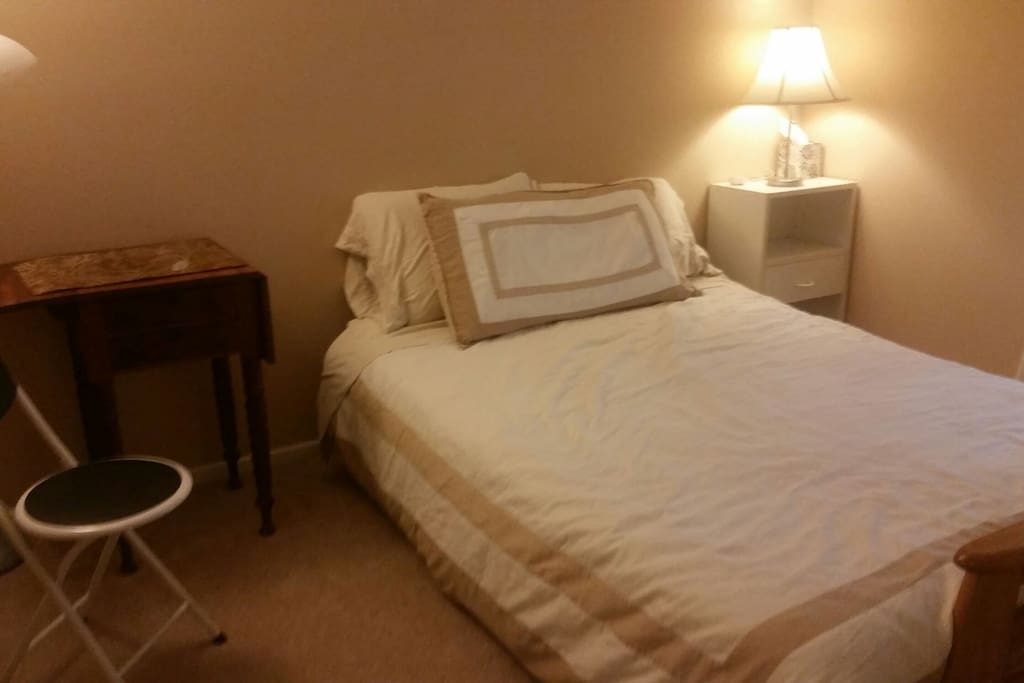 Your room has a full/double futon (the mattress is a little older but we have added pads for extra cushion) and a small antique table suitable for working at your laptop.