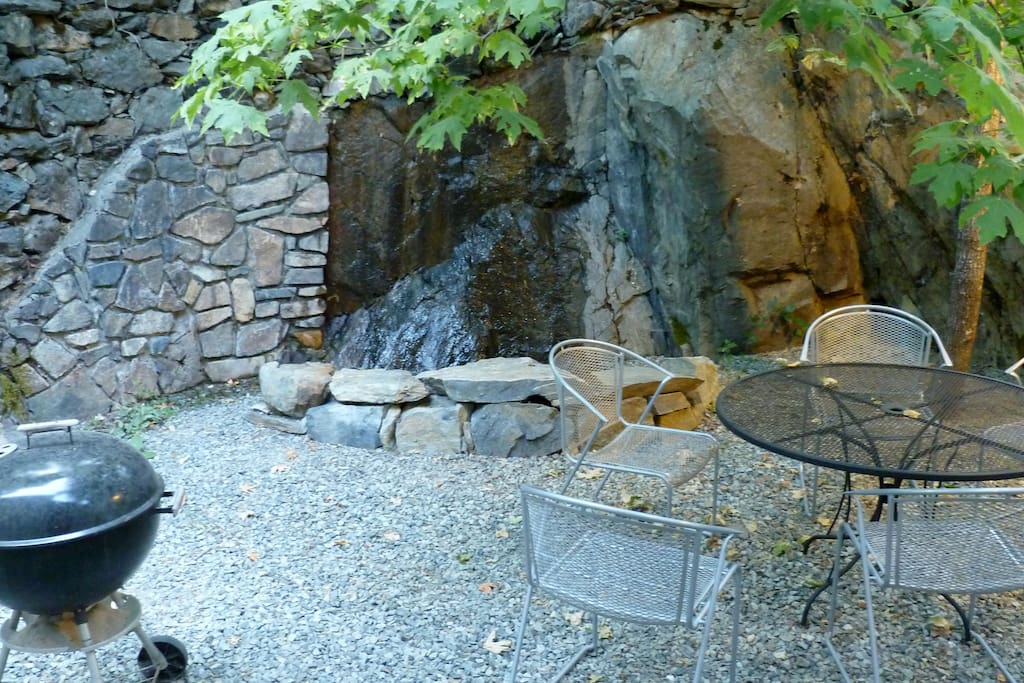 Backyard patio and small relaxing waterfall feature.