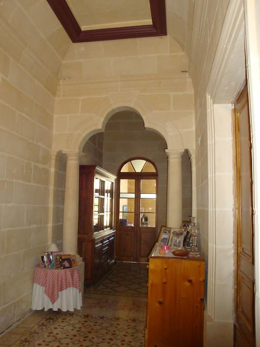 high ceilings, stone works and typical 1930's floor tiles